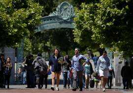 People stroll through Sproul Plaza in front of Sather Gate on the Cal campus in Berkeley, Calif., on Friday, May 28, 2010. Enrollment in the summer session at UC Berkeley has set new records this year.
