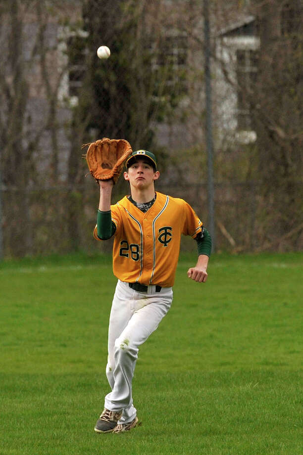 Trinity Catholic center fielder Daniel Bernard catches a ball hit to him during the Crusaders' baseball game against Darien at Trinity Catholic High School in Stamford, Conn., on Monday, April 27, 2015. Darien won, 9-0. Photo: Jason Rearick / Jason Rearick / Stamford Advocate