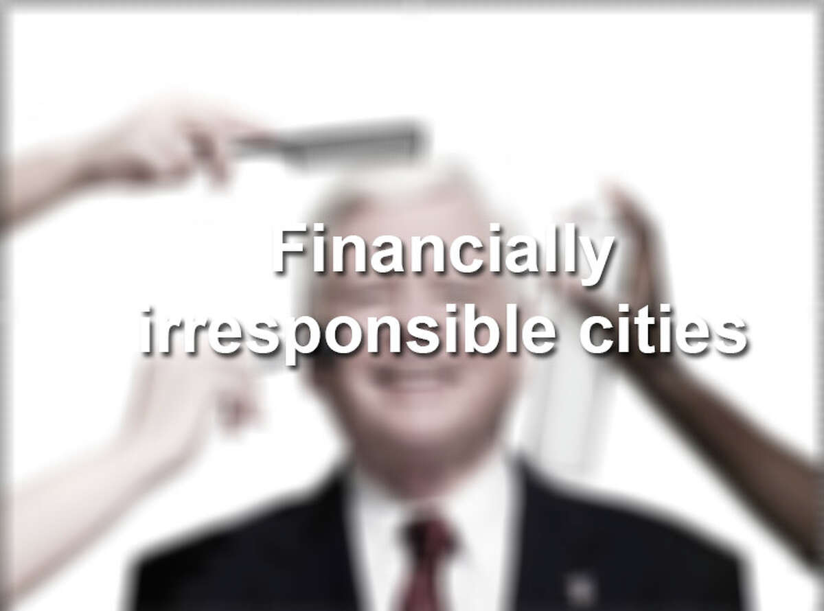 Click through the slideshow to see the 15 most financially irresponsible cities in the U.S., as well as what we think the communities may be spending all their money on.
