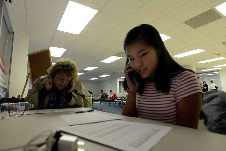 Lily Shive, 13, of Shelton, Conn., at right, along with her mother Benay Shive, joined a group of volunteers at the Stamford Democratic Headquarters on March 31, 2016, to make calls  to Stamford residents reminding them to vote in the upcoming state primary. Photo: File Photo / Hearst Connecticut Media / Stamford Advocate