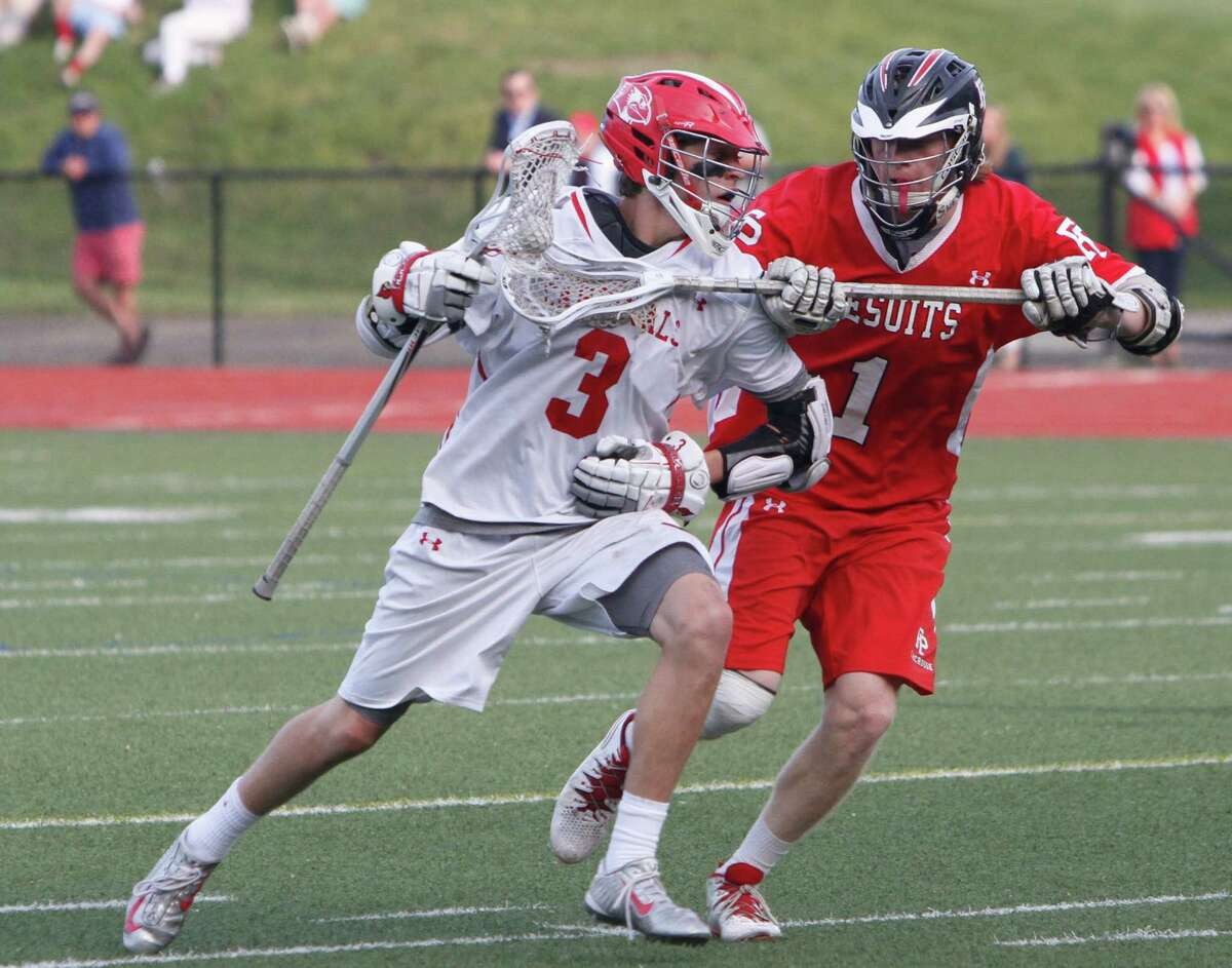 Greenwich's Will Perry drives under pressure from Fairfield Prep's Colin Smalkais during the first round Class L boys lacrosse at Greenwich High School in Greenwich, Conn. on Wednesday, June 3, 2015. Greenwich defeated Fairfield Prep 11-6.