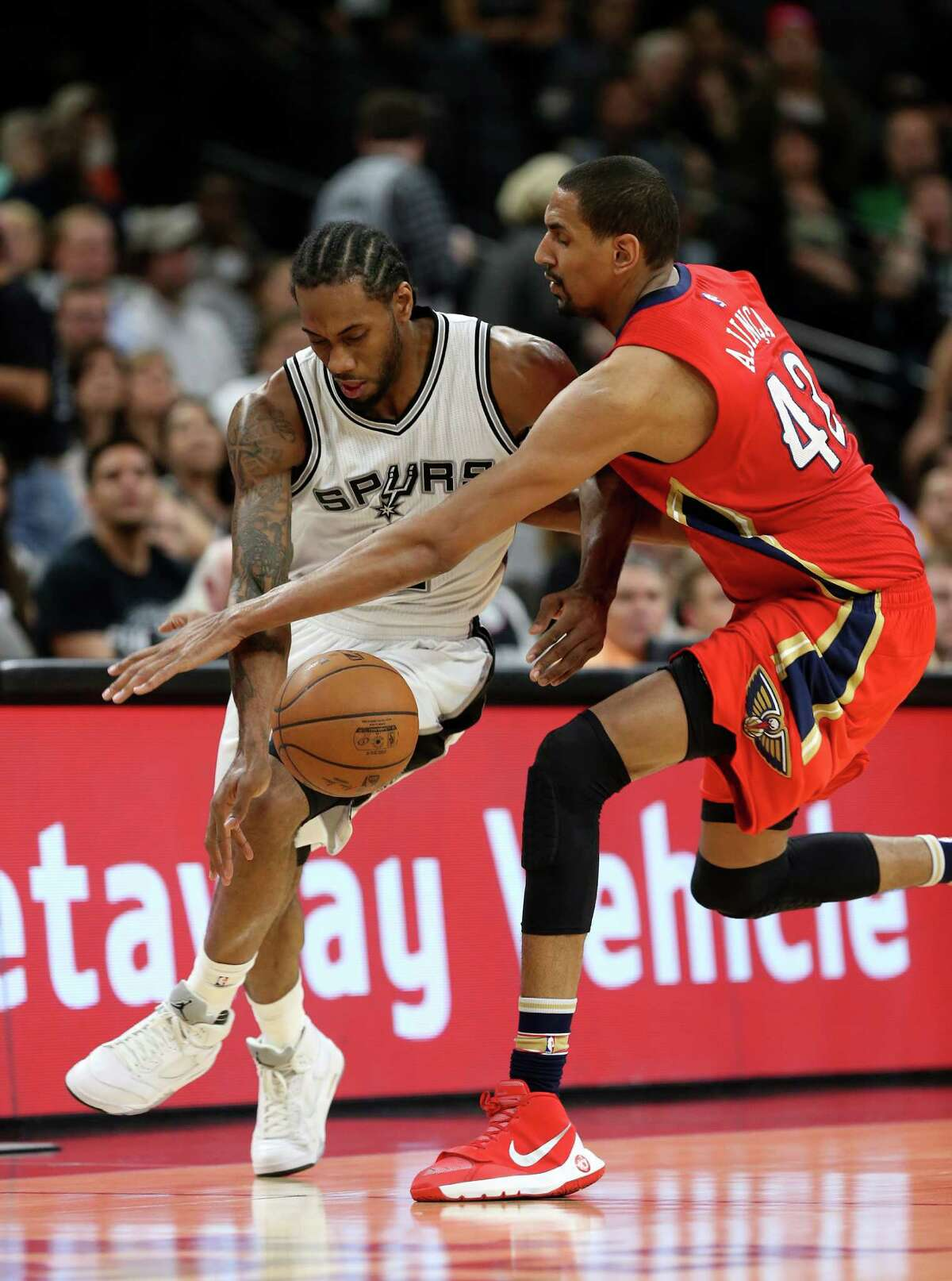 San Antonio Spurs' Kawhi Leonard steal the ball from New Orleans Pelicans' Alexis Ajinca during the first half at the AT&T Center, Wednesday, March 30, 2016.