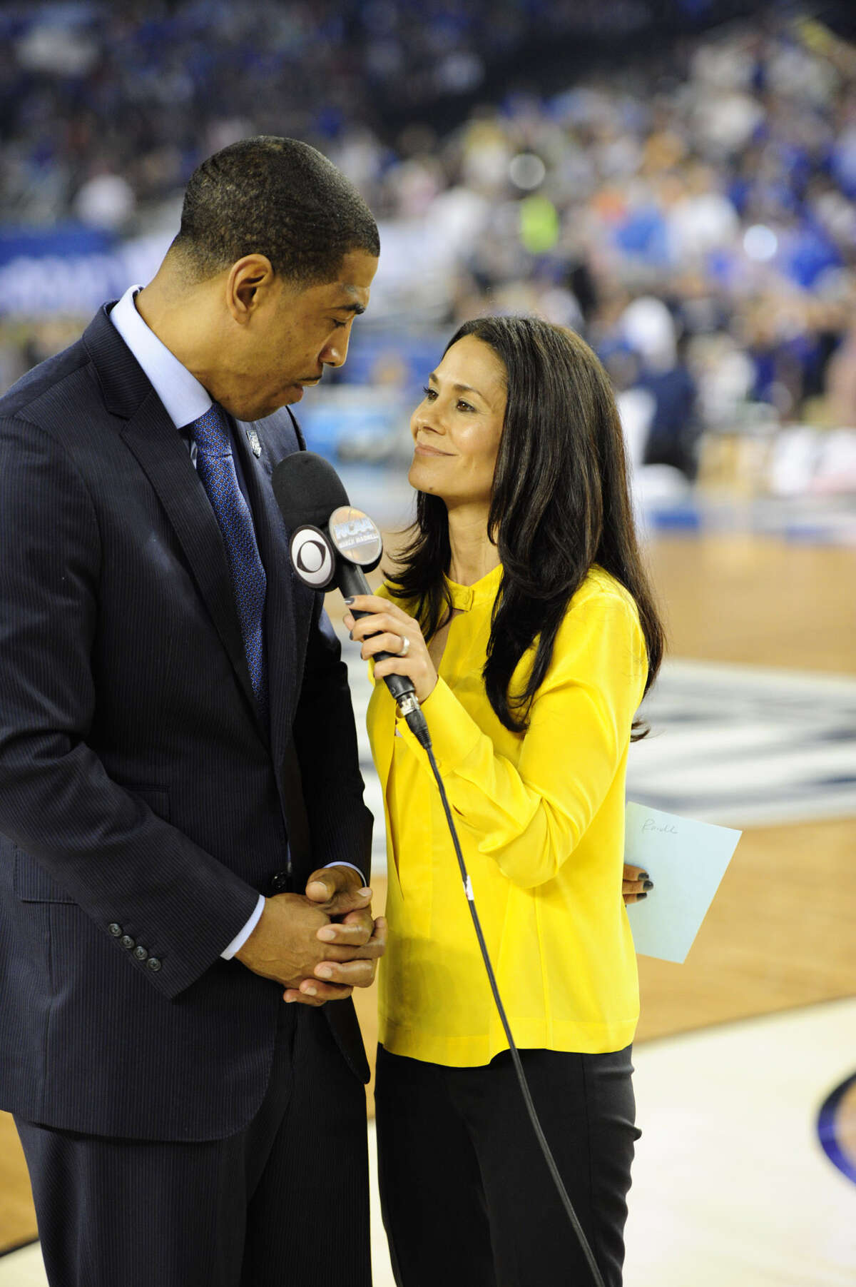 2014 NCAA FINAL FOUR IN NORTH TEXAS. MONDAY Championship game Winning UConn head coach Kenin Ollie and cbs Reporter Tracy Wolfson. CBS photo by John P. Filo c.2014 CBS BROADCASTING INC. ALL RIGHTS RESERVED