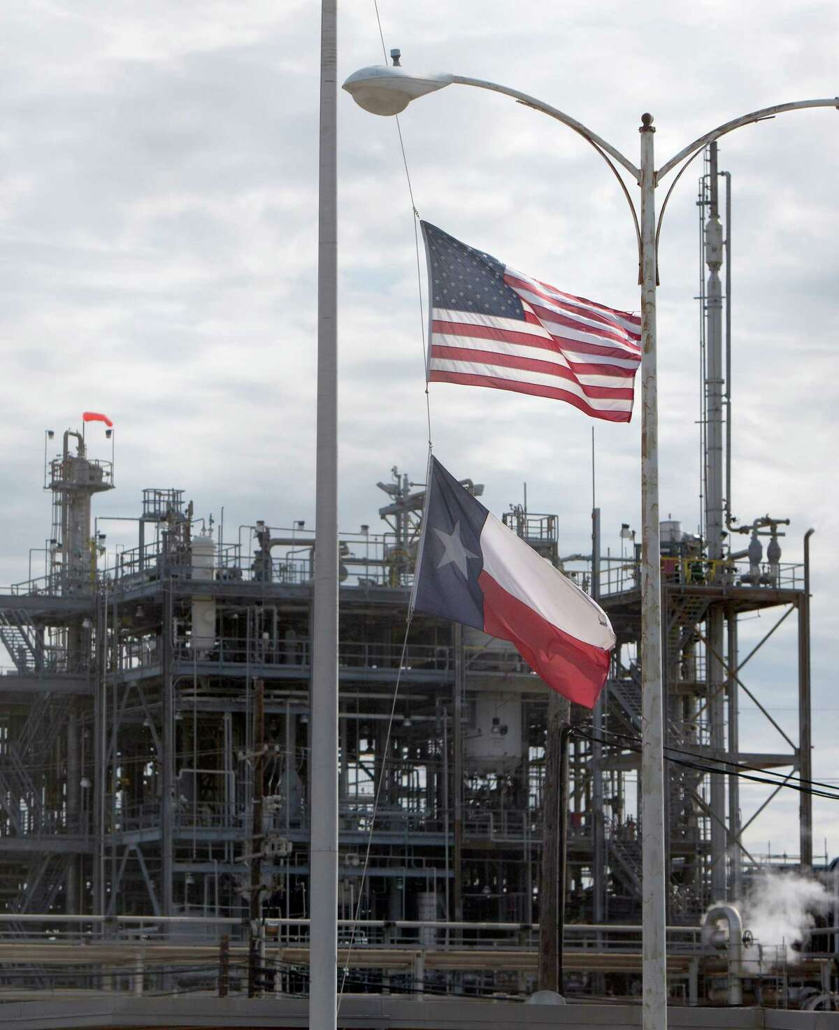 Flags at the DuPont plant in La Porte fly at half-staff in November 2015, a year after the gas leak that left four dead. The accident led to a federal probe that faulted safety practices companywide.