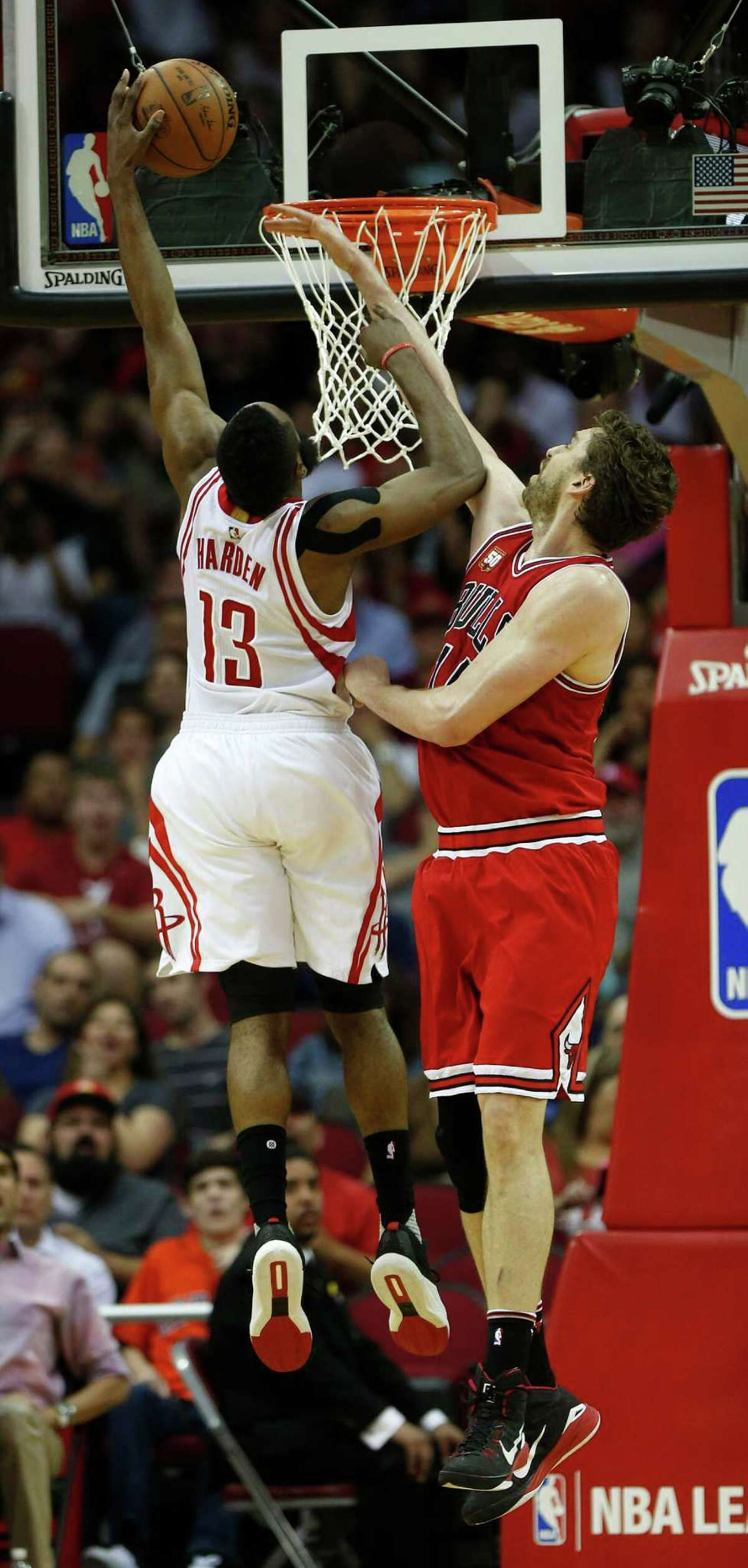 Houston Rockets guard James Harden (13) was fouled by Chicago Bulls center Pau Gasol (16) during the second half of an NBA basketball game at Toyota Center, Thursday, March 31, 2016, in Houston.