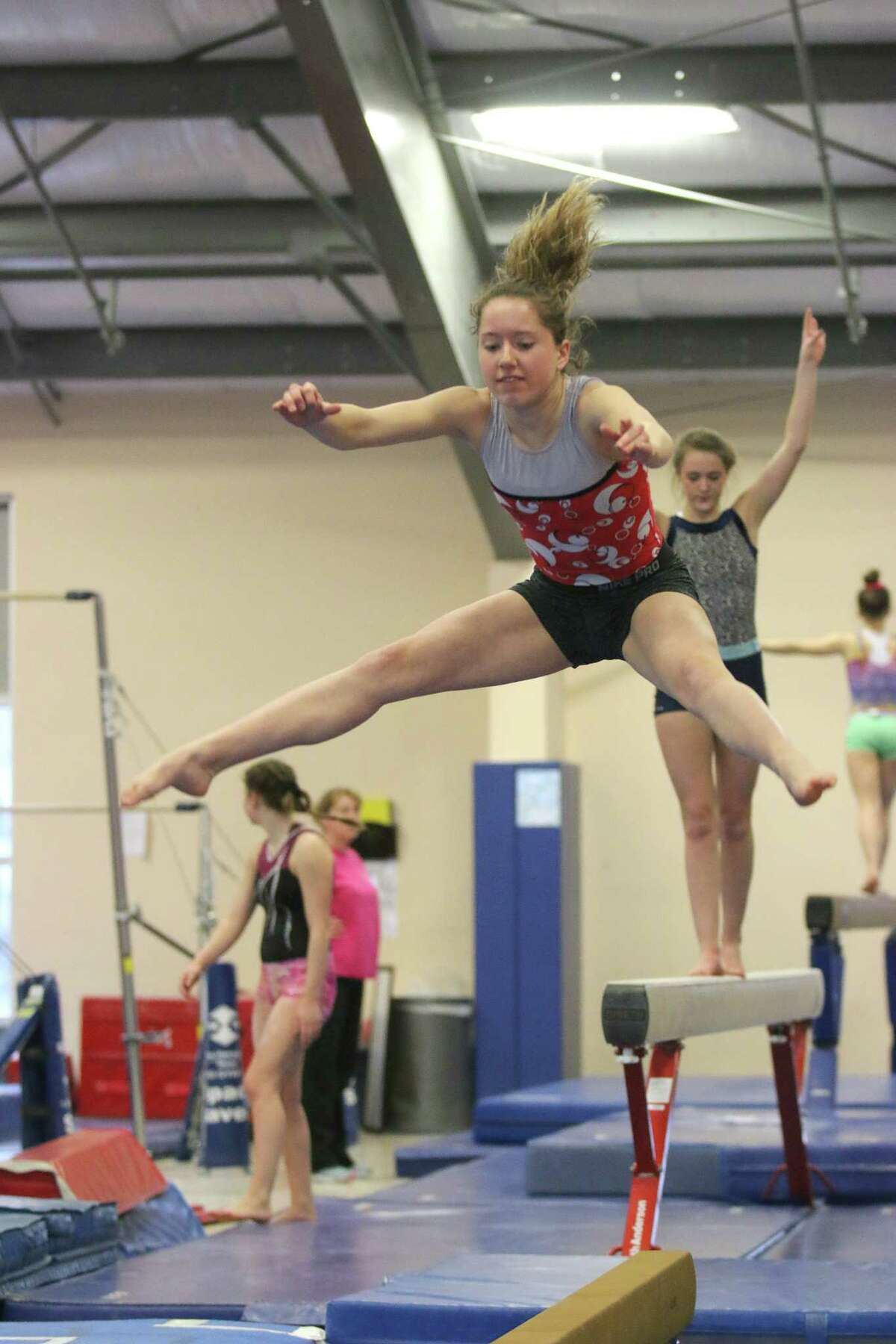 Gymnast Julia Van Horne practices on the balance beam Thursday with the Saratoga Regional YMCA Springettes at their gym in Wilton March 31, 2016. (Ed Burke/Special to The Times Union)