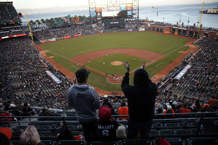 Fans cheer as the San Francisco Giants take the field to play the Oakland A's in the Bay Bridge Series at AT&T Park in San Francisco, Calif., on Thursday, March 31, 2016. Photo: Scott Strazzante, The Chronicle