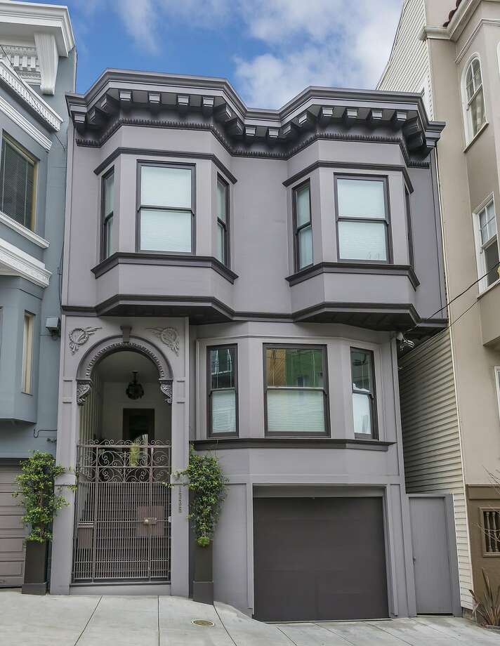 Embellishments within the facade's arched portico and dentils beneath the roof lend understated elegance to the listing. Photo: Olga Soboleva / Vanguard Properties