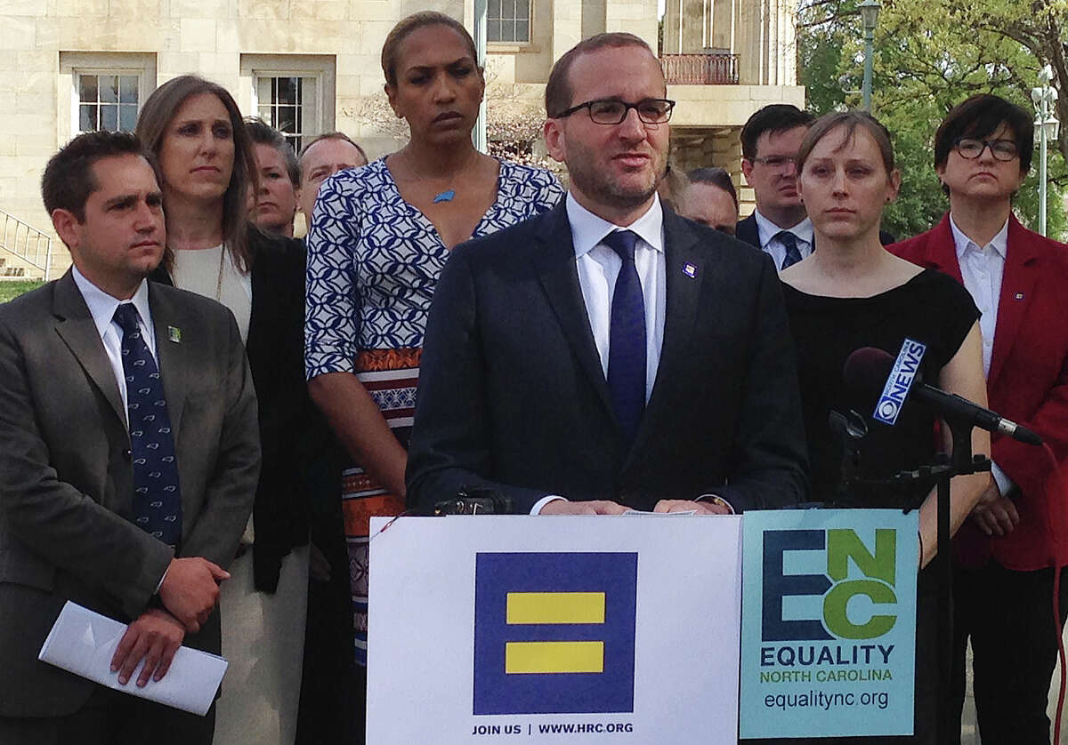 Human Rights Campaign president Chad Griffin, center, speaks at a news conference at the old state Capitol Building in Raleigh, N.C. on Thursday, March 31, 2016. Griffin, Equality North Carolina Executive Director Chris Sgro, far left, and others delivered a letter to Gov. Pat McCrory signed by more than 100 corporate executives calling for repeal of a law limiting bathroom options for transgender people and prohibiting local anti-discrimination measures providing protections on the basis of sexual orientation and gender identity. (AP Photo/Gary Robertson)