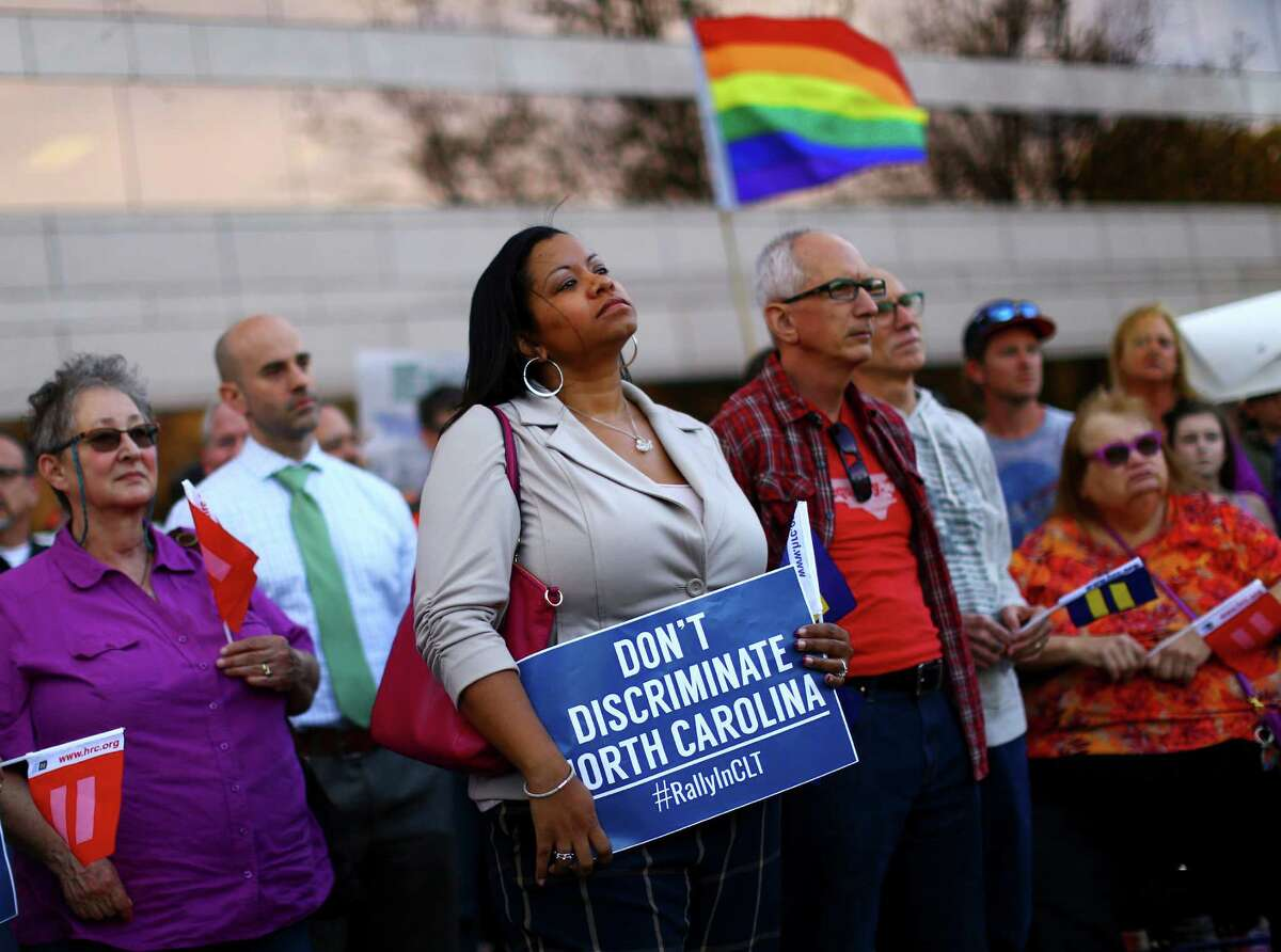 Demonstrators rally in Charlotte, N.C., on March 24, a day after North Carolina passed a law forbidding cities from enacting anti-discrimination protections for the LGBT community. Gov. Dannel Malloy barred state-paid travel to North Carolina, citing the state's new law restricting restroom use by transgender people.