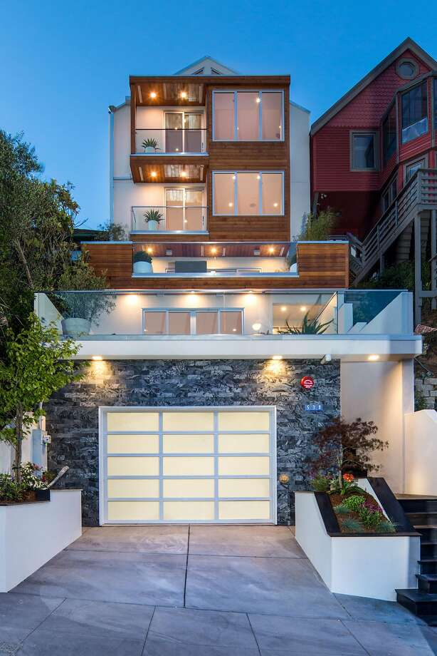 Steel, timber, glass, and stucco fashion the facade of this five-bedroom Noe Valley home that includes a three-car garage. Photo: Marcell Puzsar Photography