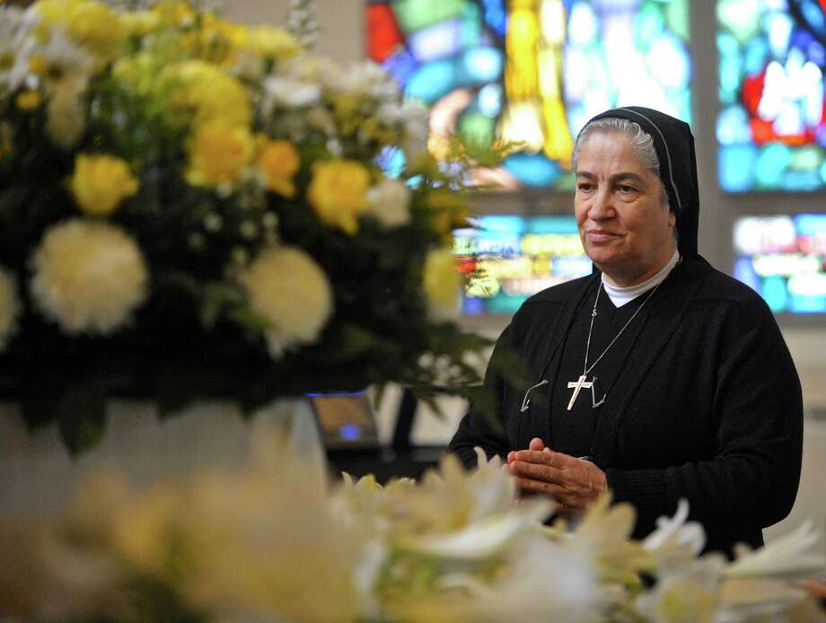 Sister Mary Margaret Kiwan, of the Holy Family Maronite order, prays in front of the relics of Saint Charbel Makhlouf at St. Anthony's Church, in Danbury. The church is hosting the relics for a two-day visit. Thursday afternoon, March 31, 2016, in Danbury, Conn. It is the 50th anniversary of St. Charbel's beatification. Photo: H John Voorhees III / Hearst Connecticut Media / The News-Times