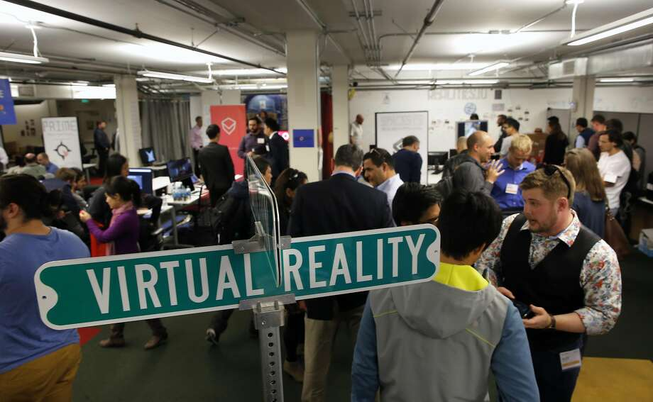 After the presentations at the Boost VC event, participants talk about their projects and visions for virtual reality. Photo: Michael Macor, The Chronicle