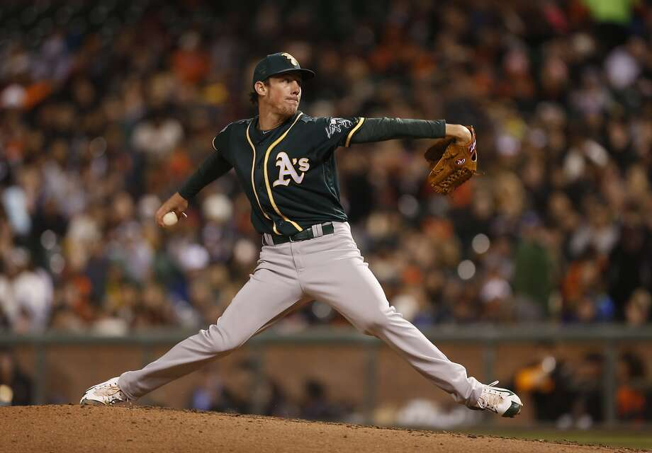 Oakland Athletics pitcher Chris Bassitt winds up during the fourth inning of the first game of the Battle of the Bay Series against the San Francisco Giants on Thursday, March 31, 2016 in San Francisco, Calif. Photo: Beck Diefenbach, Special To The Chronicle