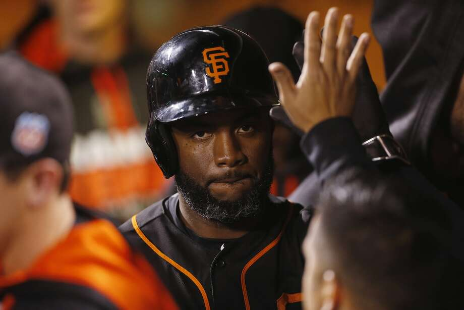 San Francisco Giants' Denard Span is congratulated after scoring a run on a double hit by Buster Posey during the fifth inning of the first game of the Battle of the Bay Series against the Oakland Athletics on Thursday, March 31, 2016 in San Francisco, Calif. Photo: Beck Diefenbach, Special To The Chronicle