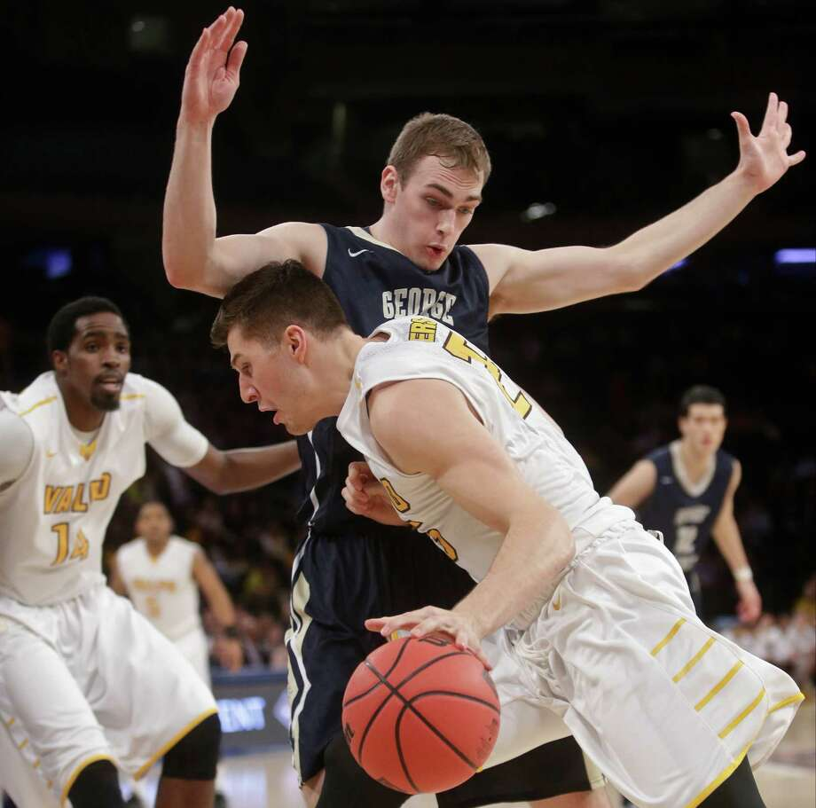 Valparaiso's Alec Peters (25) drives past George Washington's Tyler Cavanaugh (34) during the first half of an NCAA college basketball game in the final of the NIT on Thursday, March 31, 2016, in New York. Photo: Frank Franklin II, AP / AP