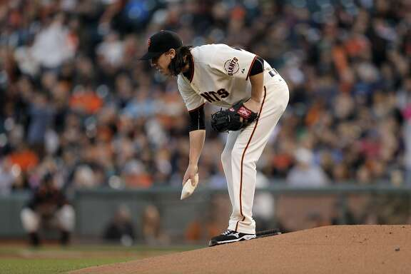 Tim Lincecum (55) picks up the rosin bag after giving up a three-run homerun to Nolan Arenado (28) in the first inning. The San Francisco Giants played the Colorado Rockies at AT&T Park in San Francisco, Calif., on  Wednesday, April 15, 2015.