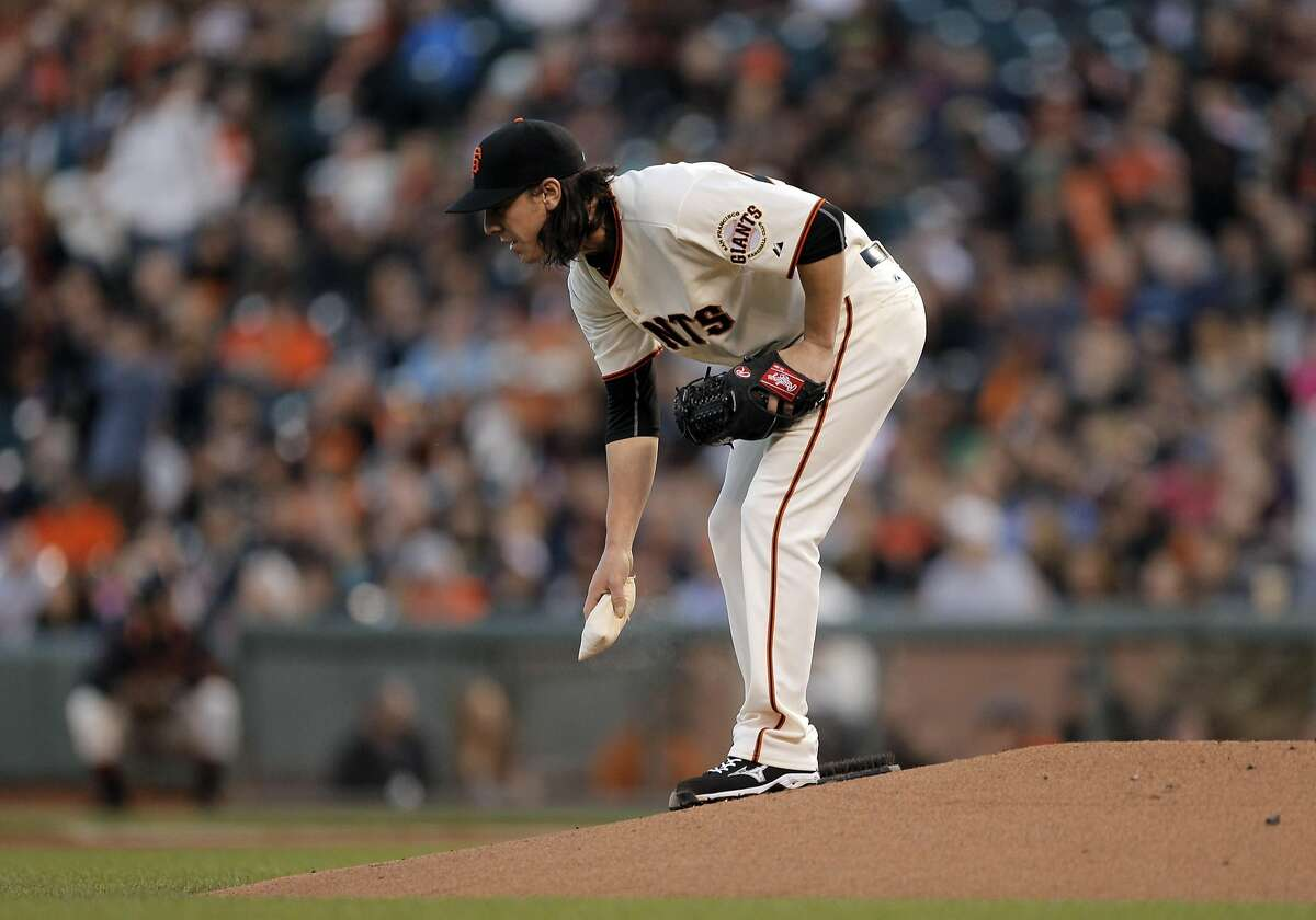 Tim Lincecum picks up the rosin bag after giving up a three-run homerun to the Colorado Rockies at AT&T Park in San Francisco, Calif., on Wednesday, April 15, 2015.