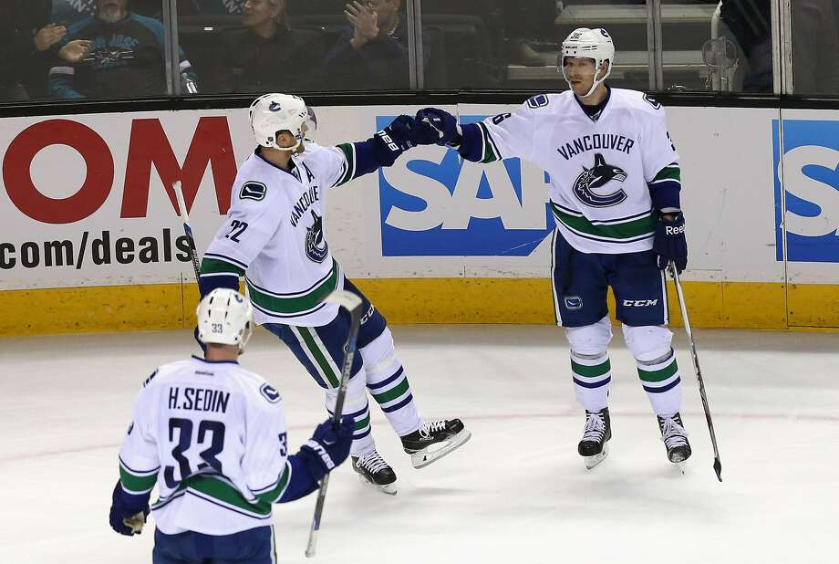 Jannik Hansen (right) is congratulated by twins Daniel and Henrik Sedin after his goal put the Canucks ahead with just over 5 minutes to play. Photo: Ezra Shaw, Getty Images