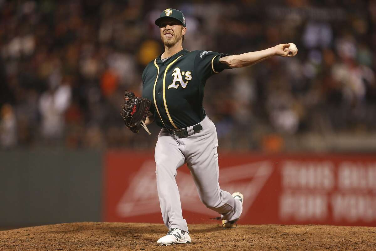 Oakland Athletics pitcher Patrick Schuster winds up during the seventh inning of the seventh game of the Battle of the Bay Series against the San Francisco Giants on Thursday, March 31, 2016 in San Francisco, Calif.