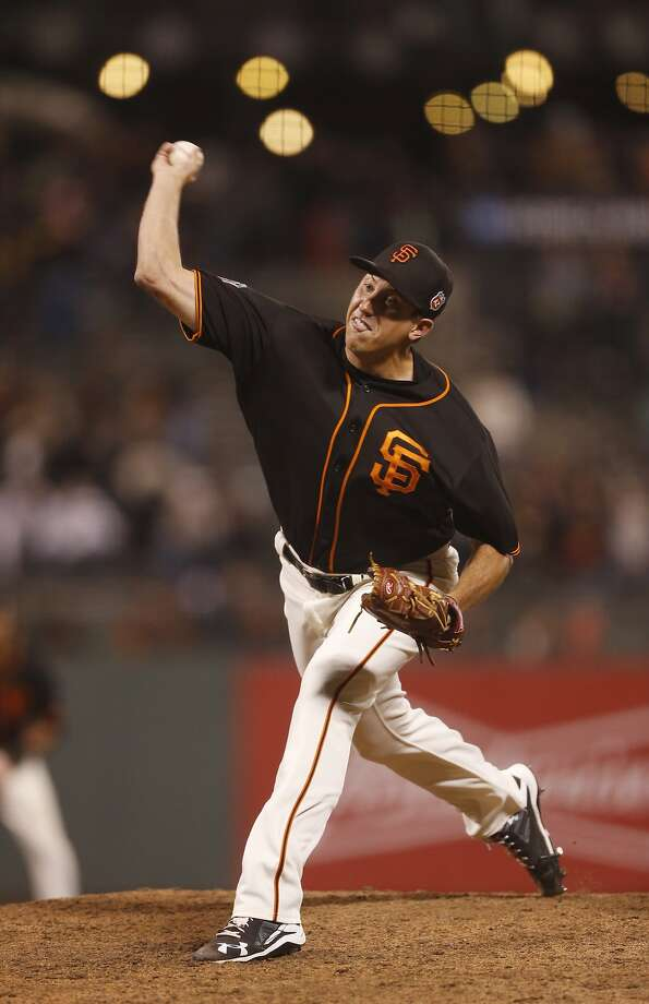 Derek Law pitches for the Giants in the March 31 exhibition at AT&T Park. Photo: Beck Diefenbach, Special To The Chronicle