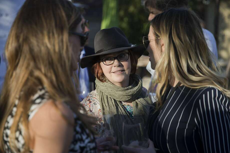 Sarah Currry (left) chats with Claire Parr and Cathi Williams at the Yountville Live event. Photo: Carlos Avila Gonzalez, The Chronicle