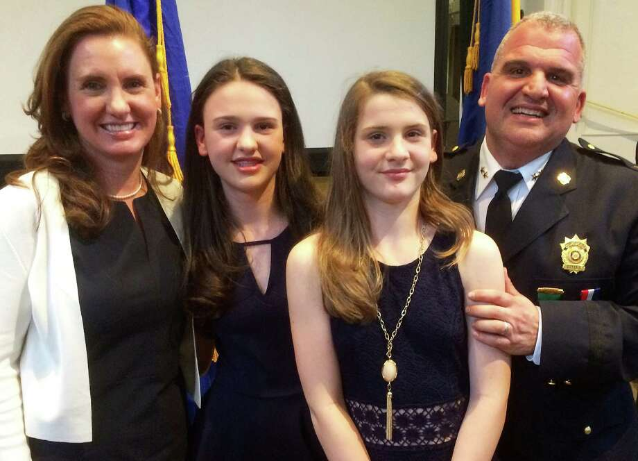 Police Chief Foti Koskinas is joined by his family at the Town Hall ceremony marking his swearing in as police chief. From left are Koskinas' wife Christina and daughters Zoe and Phoebe. Photo: Westport News / Chris Marquette / Westport News