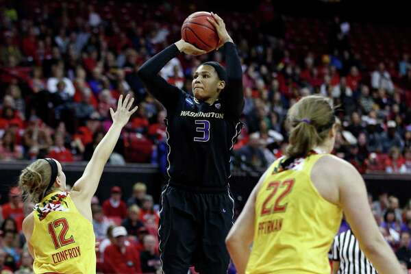 Washington forward Talia Walton, center, shoots over Maryland guard Kristen Confroy, left, and forward Tierney Pfirman in the first half of an NCAA college basketball game in the second round of the NCAA tournament, Monday, March 21, 2016, in College Park, Md. (AP Photo/Patrick Semansky)