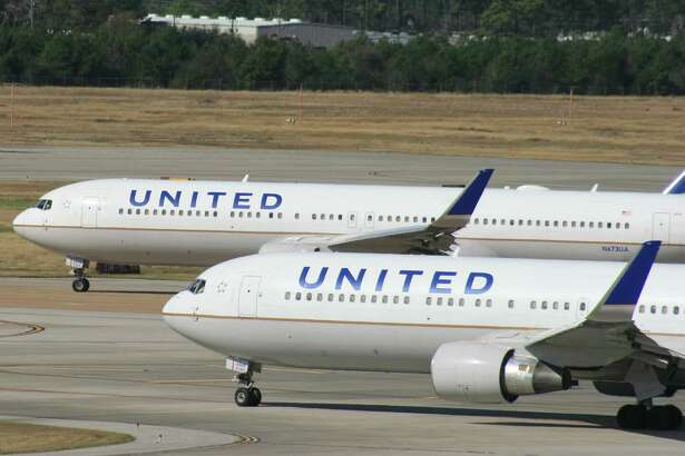 Two United Airlines Boeing 767 airliners at Houston's Bush Intercontinental Airport in January 2016.
