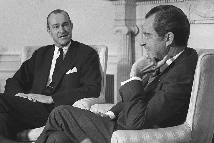 ** FILE ** Richard Helms, U.S. Ambassador to Iran, left, speaks with President Nixon, right, in this 1973 file photo at the White House in Washington. Helms, the spymaster who led the CIA through some of its most difficult years and was later fired by President Nixon when he refused to block an FBI probe into the Watergate scandal, died Tuesday night, Oct. 22, 2002. He was 89.(AP Photo/File)