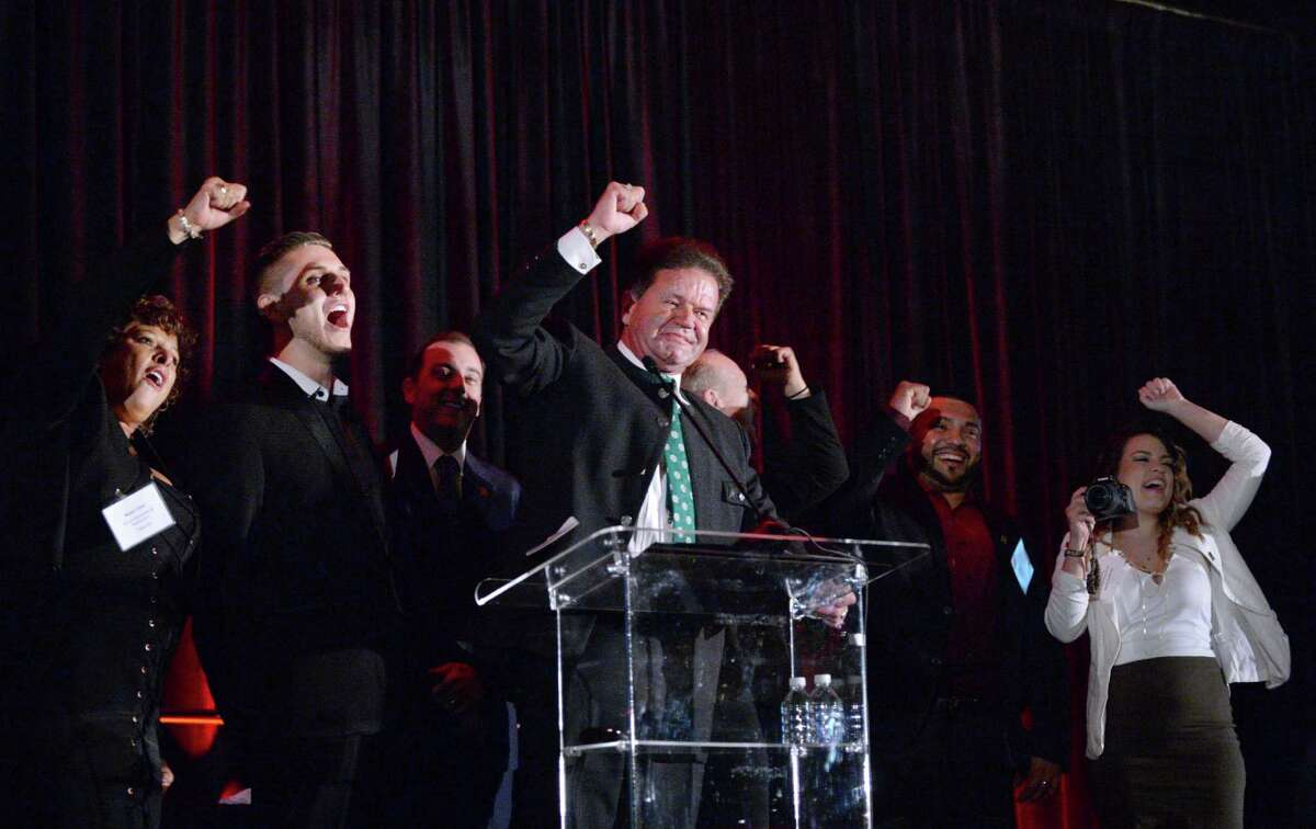Hans Sitter, center, and his son Philip, both with King's Biergarten and Restaurant cheer after receiving their award at the Houston Chronicle's annual Top Workplaces event Thursday, Nov. 5, 2015, in Houston. Take a look at all the 2015 winners in the following gallery.