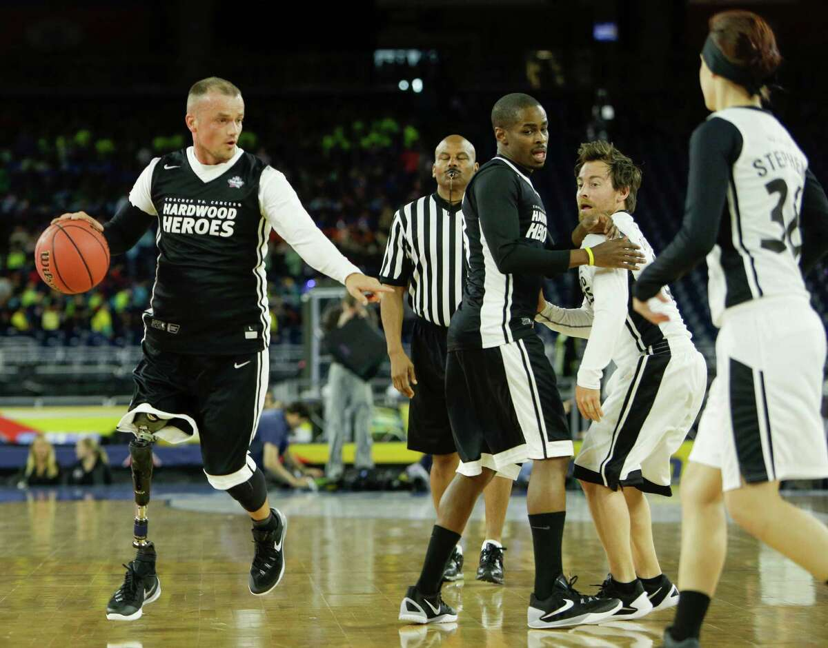Scott Odom dribbles upcourt as he plays in the Coaches vs. Cancer game before practices for the NCAA Final Four at NRG Stadiium on Friday, April 1, 2016, in Houston.