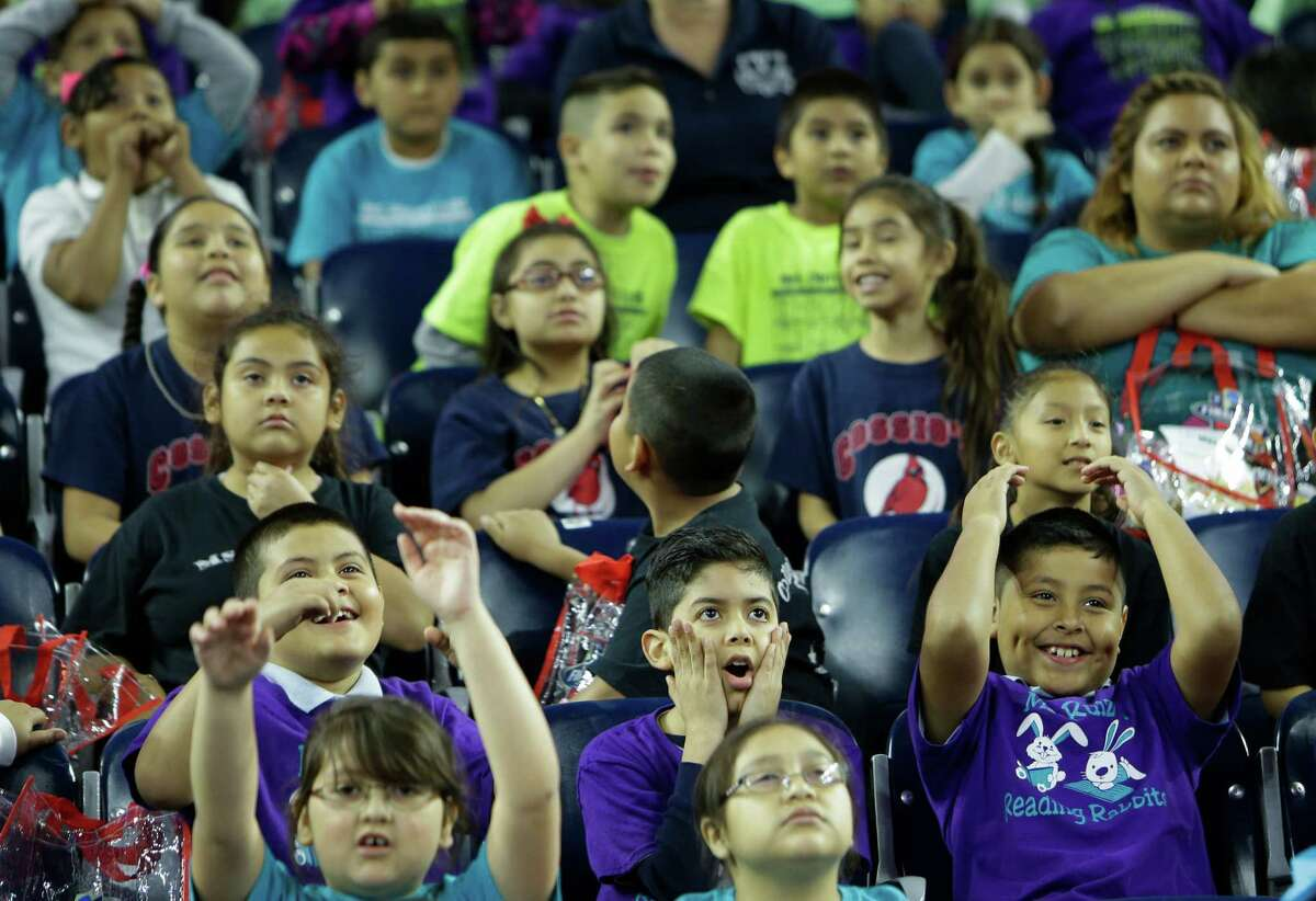 Students from Carrillo Elementary School watch the Coaches vs. Cancer basketball game before practices begin for the NCAA Final Four at NRG Stadiium on Friday, April 1, 2016, in Houston.