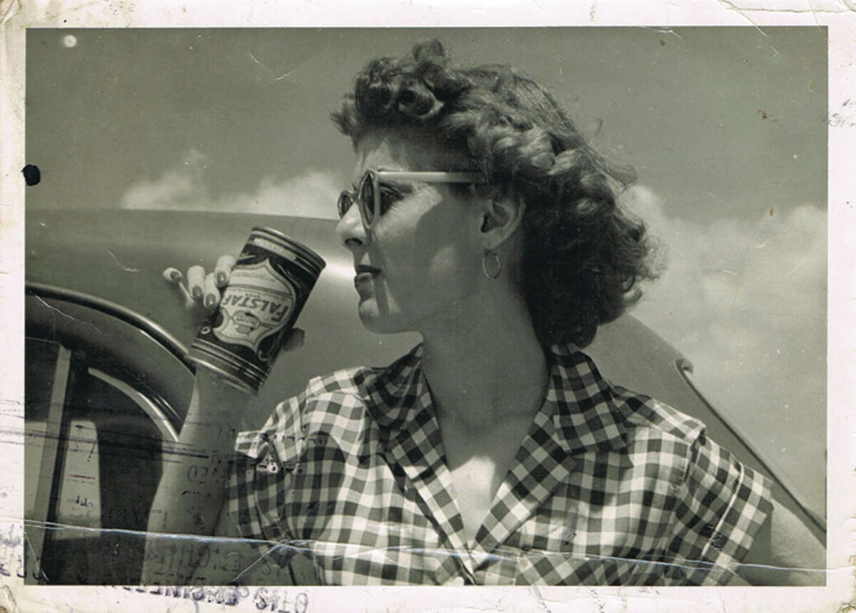The Adair Family Restaurants Group will open Eloise Nichols Grill &quors in summer 2016 at 2400 Mid Lane, Houston. The menu will come from executive chef Joseph Stayshich. Shown: Eloise Nichols, enjoying a beer in Port Aransas, Texas, 1947.