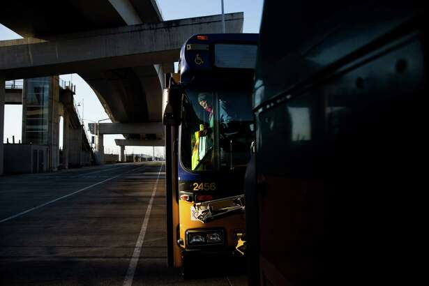 King County Metro transit operator Janice Rapier gets off the bus after finishing her 4-hour route, starting at 4 a.m., on Friday, April 1, 2016.
