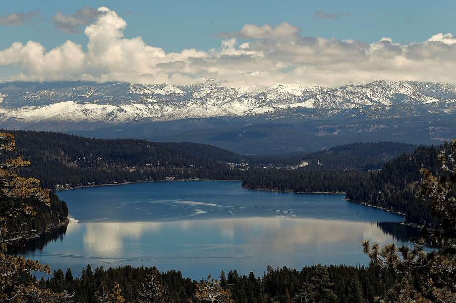 The snow-covered Eastern Sierra provides a frame for Donner Lake. With four feet of fresh snow arriving in the past week, winter has finally arrived. Photo: Michael Macor, The Chronicle