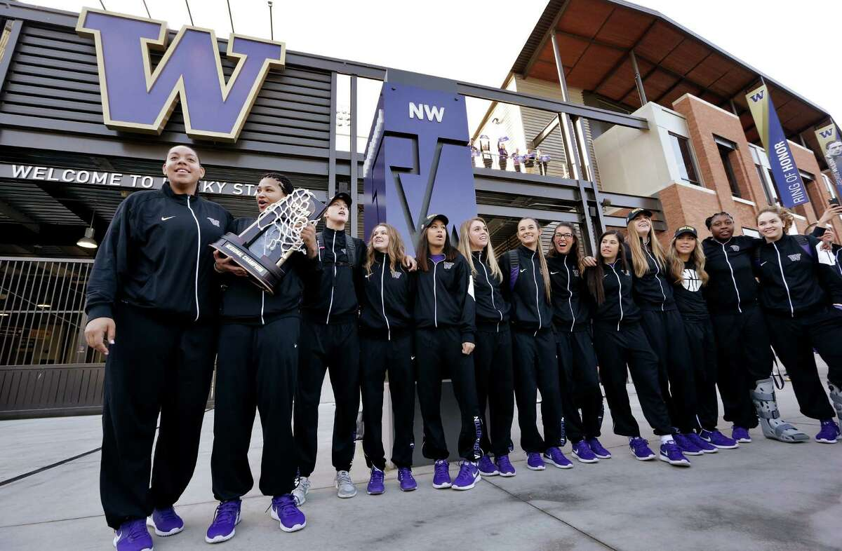 Players line up during a send-off rally for the Washington women's basketball team at Husky Stadium on Thursday, March 31, 2016, in Seattle.