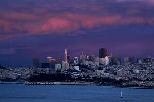 The afternoon rain showers that swept through the Bay Area left behind a dramatic San Francisco skyline as the sun sets in the Western sky, on Saturday May 28, 2011.
