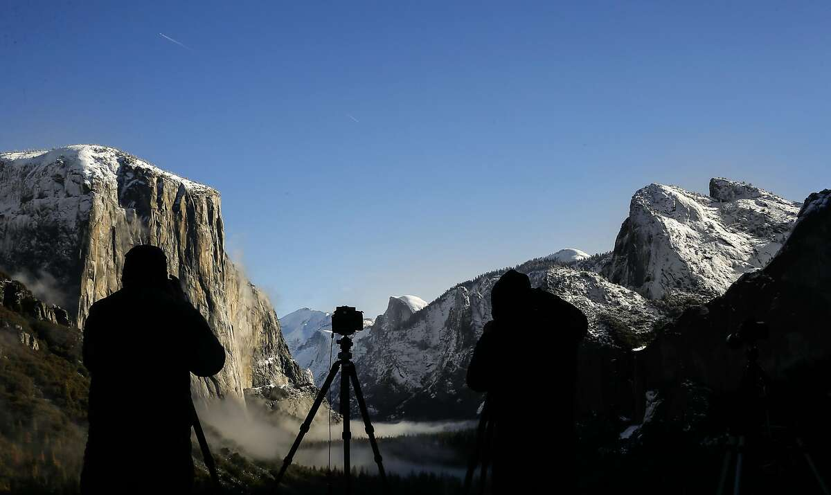 Photographers at Tunnel View overlook in Yosemite National Park, Calif. on Fri. January 15, 2016. Yosemite National Park has has agreed to change the names of The Ahwahnee to the Majestic Yosemite Hotel and Curry Village the Half Dome Village after a lawsuit filed by a contractor claimed it owned the names of the many legendary buildings and campgrounds.