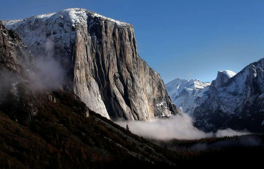 El Capitan and Half Dome with early morning fog in the valley in Yosemite National Park. Photo: Michael Macor, The Chronicle