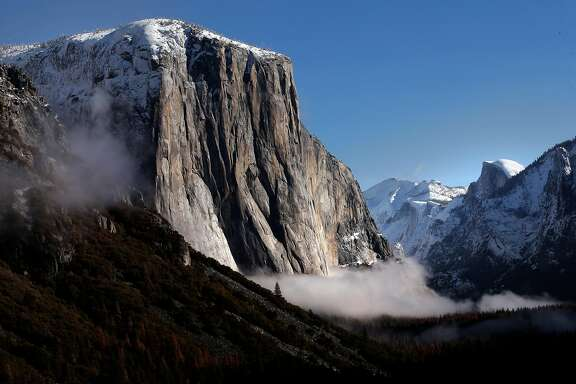 El Capitan and Half Dome with early morning fog in the valley in Yosemite National Park, Calif. on Fri. January 15, 2016. Yosemite National Park has has agreed to change the names of The Ahwahnee to the Majestic Yosemite Hotel and Curry Village the Half Dome Village after a lawsuit filed by a contractor claimed it owned the names of the many legendary buildings and campgrounds.