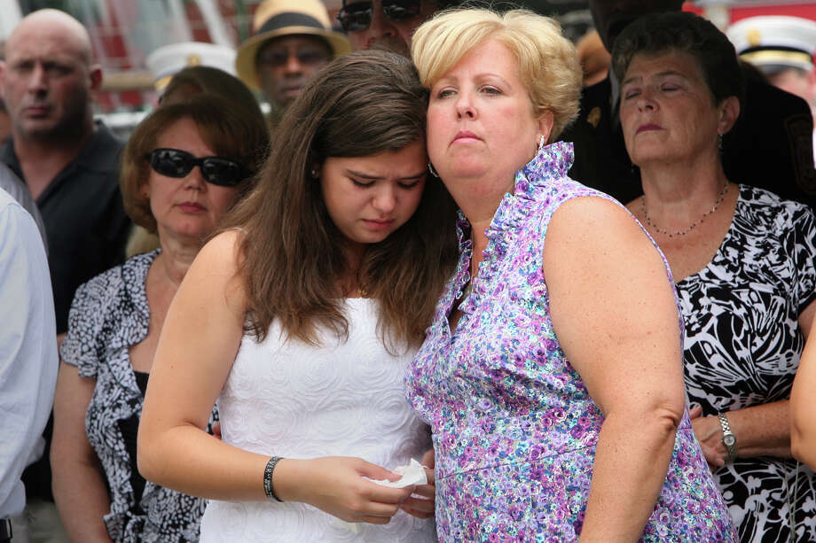 Widow Laurie Baik and her daughter, Margaret, attend a Bridgeport Fire Department Memorial Dedication ceremony honoring firefighter Michel Baik and Lt. Steven Velasquez on Sunday, July 24, 2011. Laurie Baik died on Tuesday, March 29, 2016 after a battle with cancer. Photo: B.K. Angeletti / ST / Connecticut Post