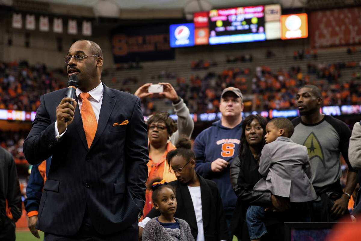 SYRACUSE, NY - NOVEMBER 2: Former NFL quarterback Donovan McNabb is honored by having his jersey retired during a Syracuse Orange football game against Wake Forest Demon Deacons on November 2, 2013 at the Carrier Dome in Syracuse, New York. Syracuse shuts out Wake Forest 13-0