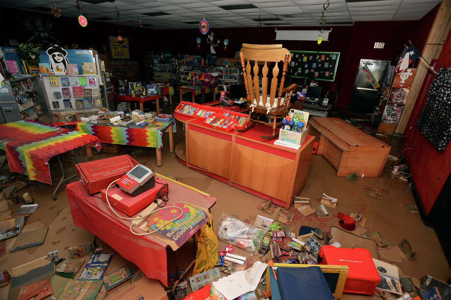 Water soaked books and furniture are spread out around the Deweyville Elementary School's library on Monday. Photo taken Monday, March 21, 2016 Guiseppe Barranco/The Enterprise Photo: Guiseppe Barranco, Photo Editor