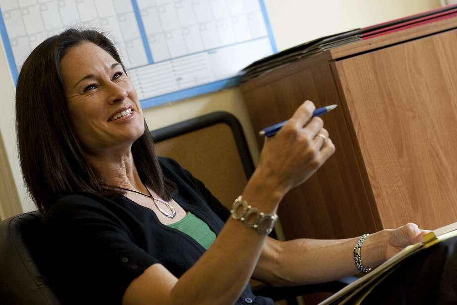 FILE - Jennifer Azzi, the new womans basketball coach for the for the University of San Francisco goes over material with her assistants their offices on June 1, 2010 in San Francisco, Calif. Photo: David Paul Morris, Special To The Chronicle