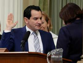Assemblyman Anthony Rendon, D-Paramount, left, is sworn-in as the 70th Speaker of the California Assembly by outgoing Speaker Toni Atkins, D-San Diego, Monday, March 7, 2016, in Sacramento, Calif.   Atkins will be leaving office due to term limits at the end of this year's legislative session. (AP Photo/Rich Pedroncelli)