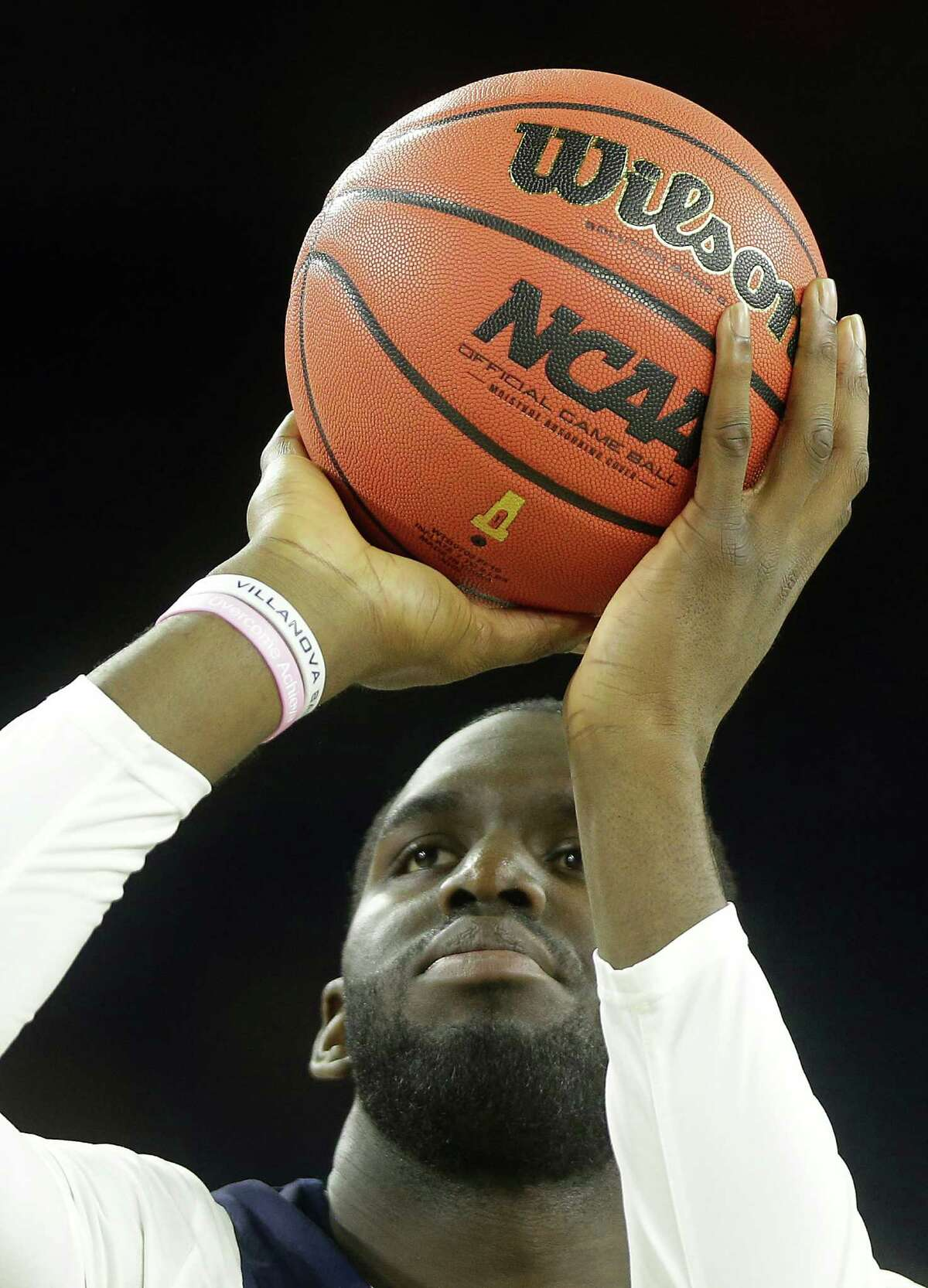 Villanova forward Daniel Ochefu shoots a free throw during practice for the NCAA Final Four at NRG Stadiium on Friday, April 1, 2016, in Houston.