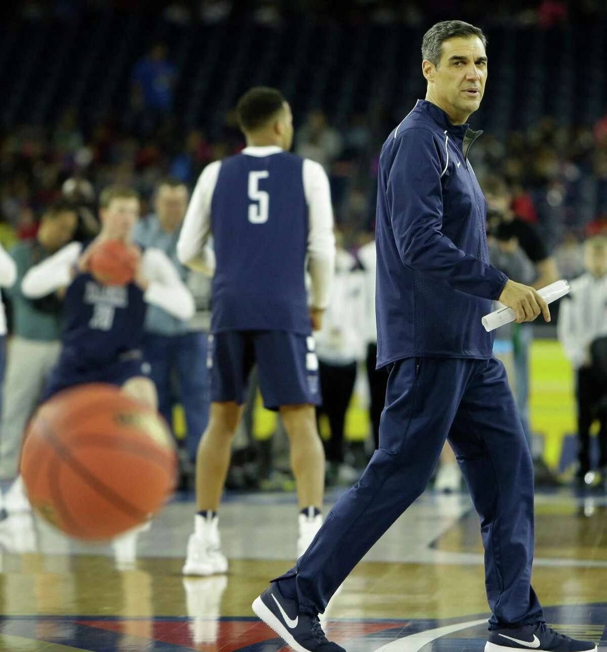 Villanova head coach Jay Wright watches practice for the NCAA Final Four at NRG Stadiium on Friday, April 1, 2016, in Houston.