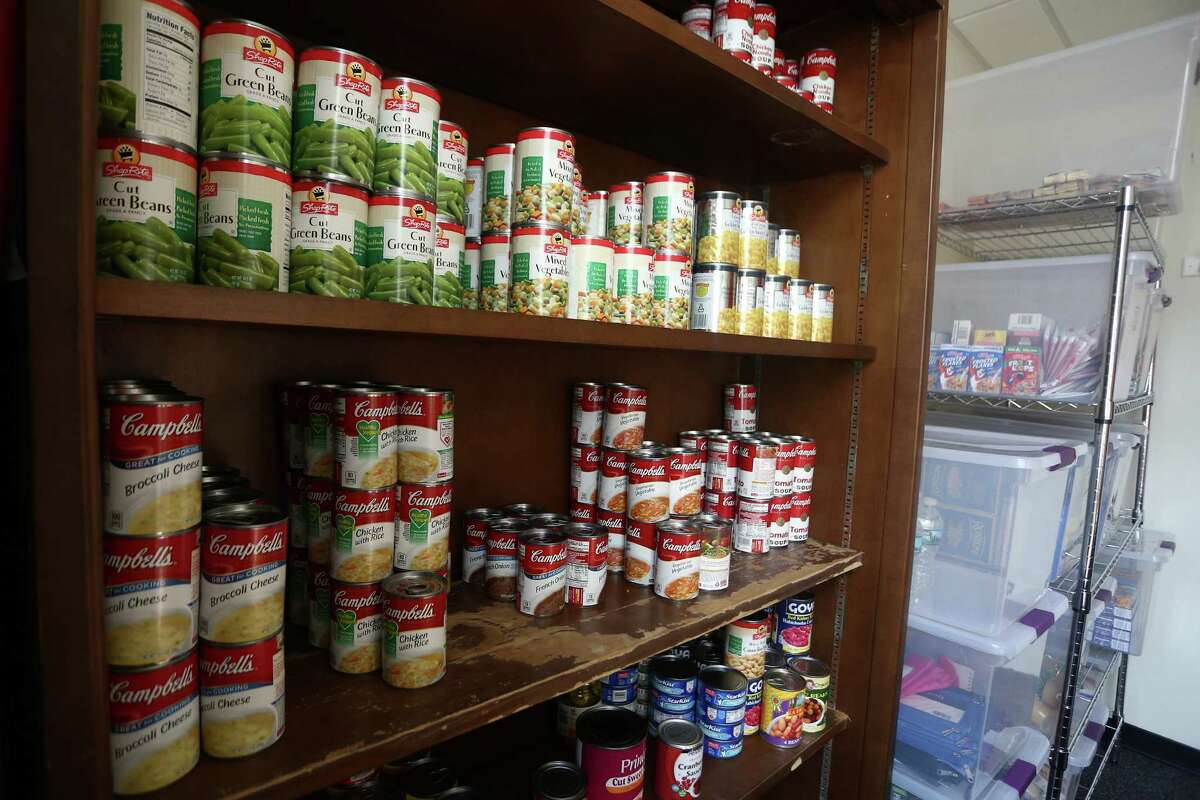 A small room inside of Stamford High School is used as a food pantry for SHS Gives Back, a student group that runs an anonymous food bank for hungry Stamford High students, on Thursday, March 31, 2016.