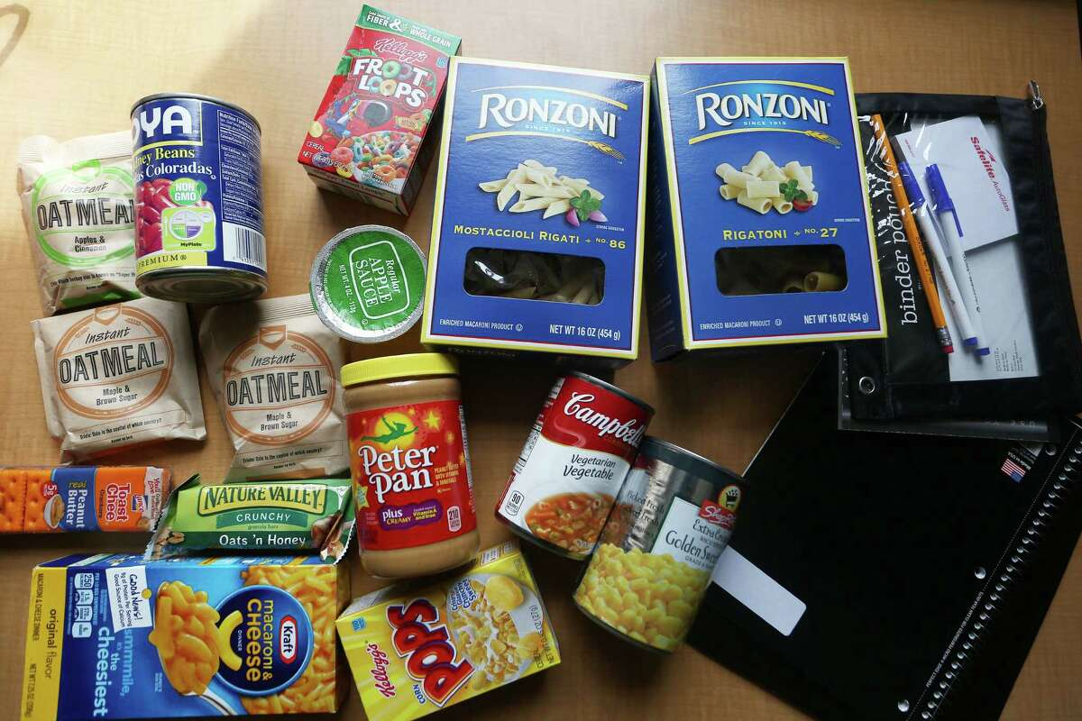 The contents of a food bag given away by SHS Gives Back, a student group that runs an anonymous food bank for hungry Stamford High students.
